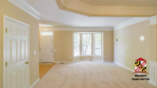Carpeting, hardwood entrance, base and crown molding
