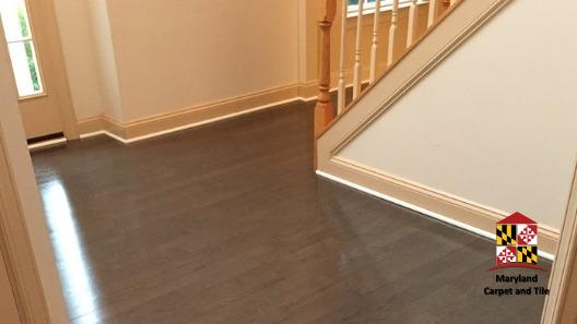 Beautiful hardwood flooring installation at the entrance to this home