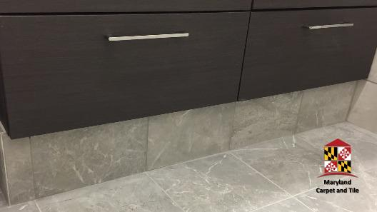 A closer look at the Acura bathroom floors and cabinet installation